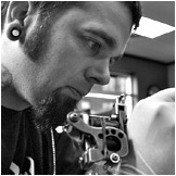 Greg Foster, tattoo artist and body piercer at Custom Tattoo, Milwaukee, Wisconsin